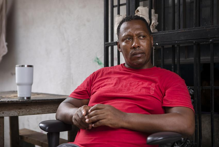 Geovanys Garcia, a Cuban migrant, sits in the courtyard of an apartment complex in Nuevo Laredo on July 23, 2019. Garcia fea…