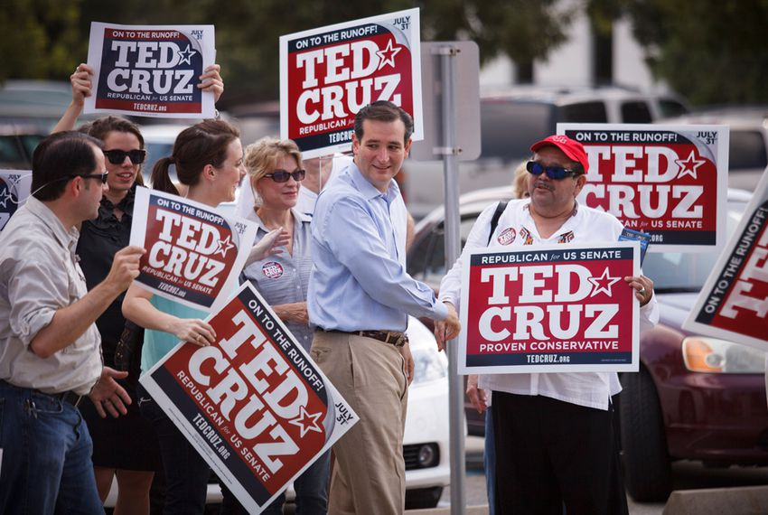 Republican Senate candidate Ted Cruz greets supporters outside a polling station in Houston, Tuesday, July 31, 2012.