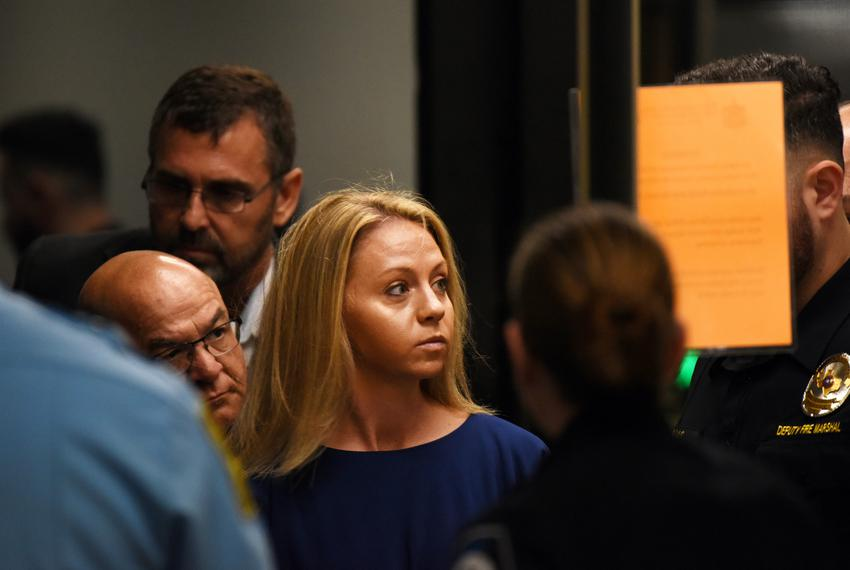Amber Guyger, who is charged in the killing of Botham Jean in his own home, arrives on the first day of the trial in Dalla...