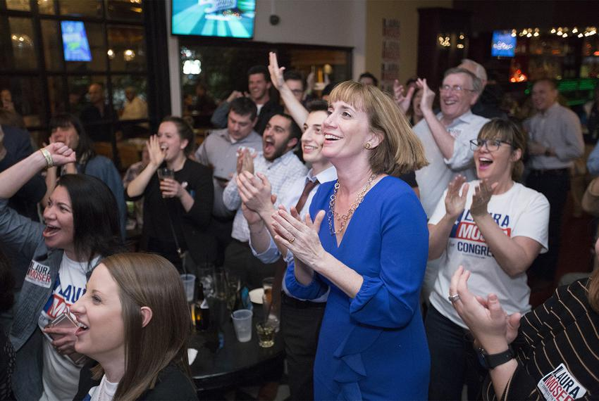 Democratic primary candidate for the 7th congressional district Laura Moser cheers with supporters at a watch party in Houst…