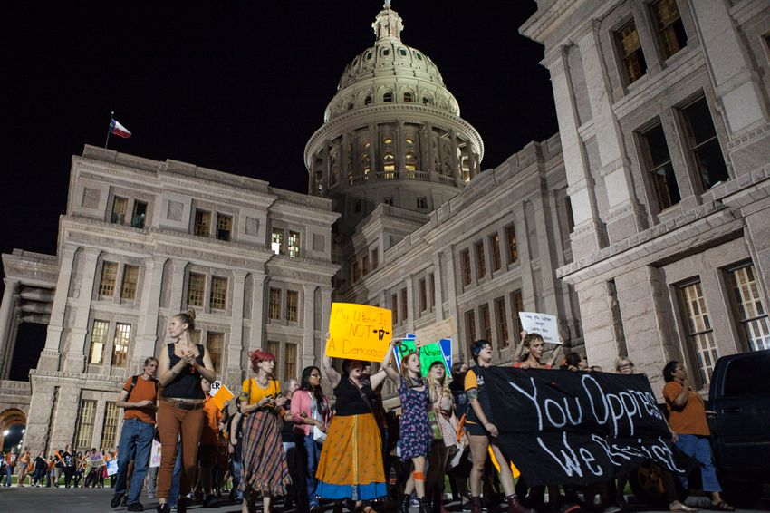 Abortion rights protesters march out of a House State Affairs Committee hearing on July 3, 2013.
