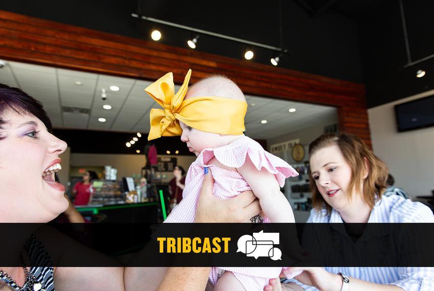 Abilene doula Sabrina Elliott holds up a baby.