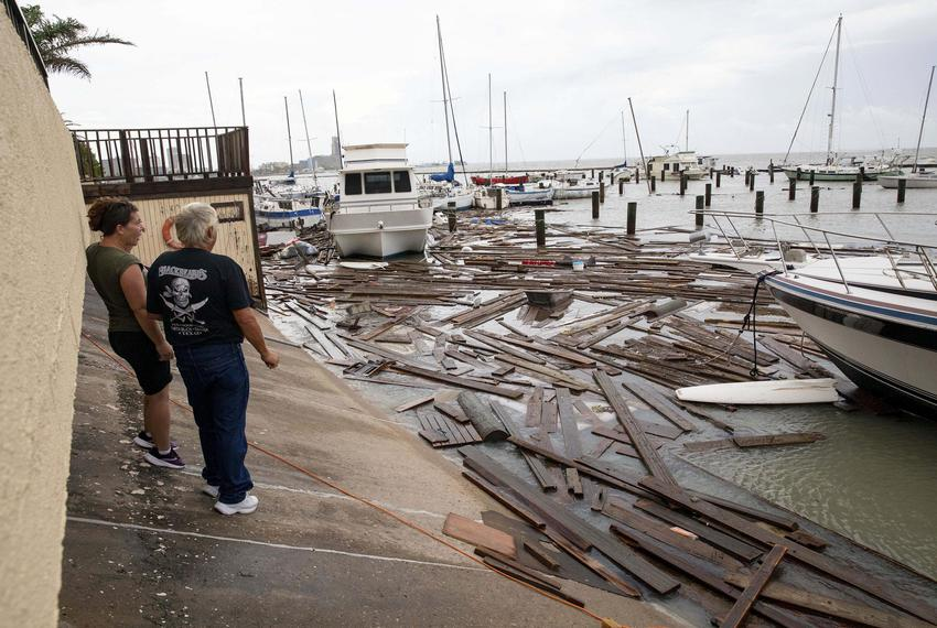 Boat owners survey the damage at Harbor Del Sol Marina the morning after Hurricane Hanna in Corpus Christi.