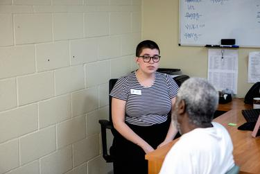 Hope Beaver, a complex needs case manager at Austin Street Center, speaks with a client.