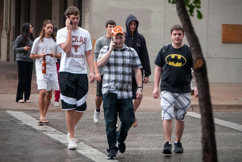 Evacuated UT students wandered into downtown Austin while they waited for news about the bomb threat on campus. (September 1…