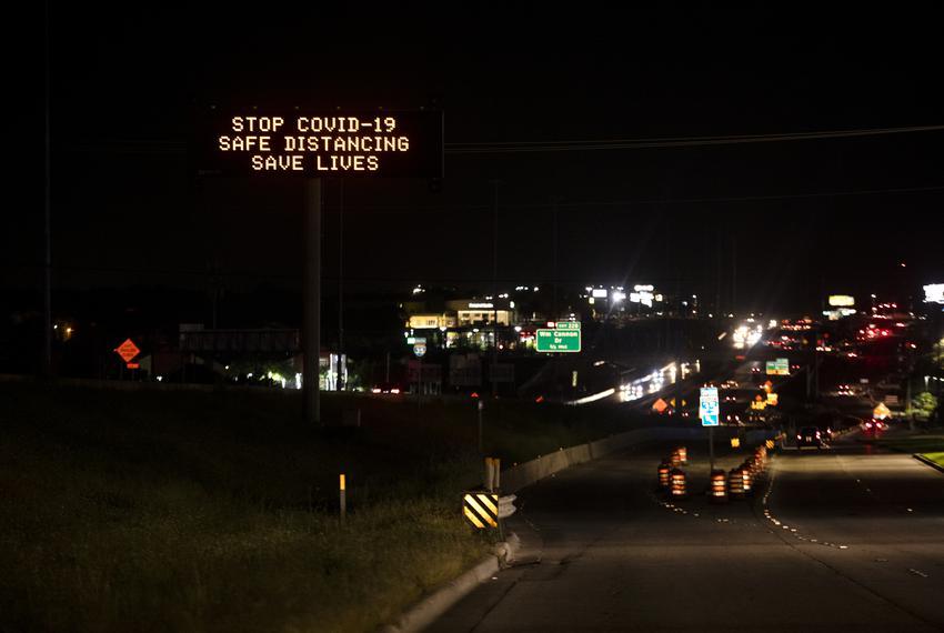 A coronavirus message on a TXDOT sign off of I-35, near Stassney Lane on April 12, 2020.