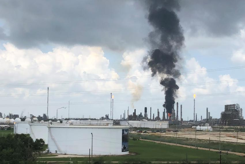Smoke rises from a fire at Exxon Mobil's refining and chemical plant complex in Baytown on July 31, 2019.