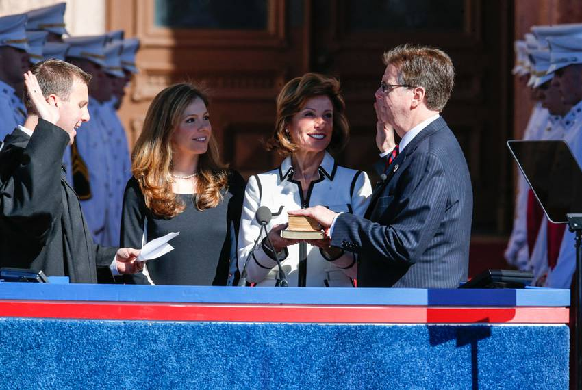 Dan Patrick is sworn in by his son Ryan, a state district judge in Harris County,while his daughter Shane and his wife, Ja...