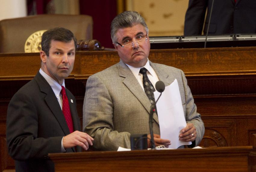 State Rep. David Simpson (l), R-Longview, and State Rep. Allen Fletcher (r), R-Tomball, look for votes on the House floor ...