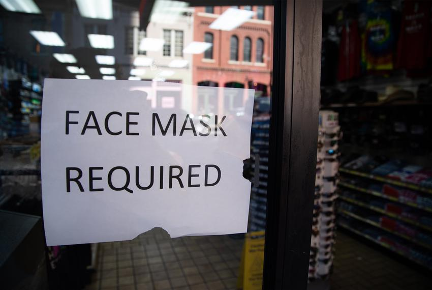 A sign outside of a store in Downtown Austin asking customers to wear a mask inside the business on March 3, 2021.