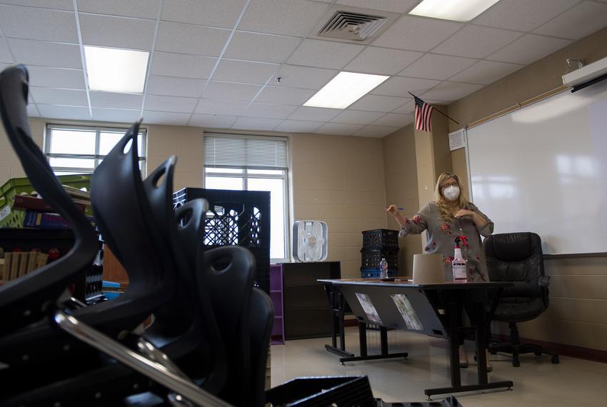 Freshman English teacher Sandra Grogan explains to another teacher how she plans to arrange her classroom at Judson High Sch…