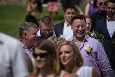 """Over 40 same-sex couples and hundreds of friends, family members and supporters gathered on the south lawn of the Texas State Capitol in Austin for the first ever """"Big Gay Wedding"""" that married any same-sex couples who presented a valid marriage license on July 4, 2015."""