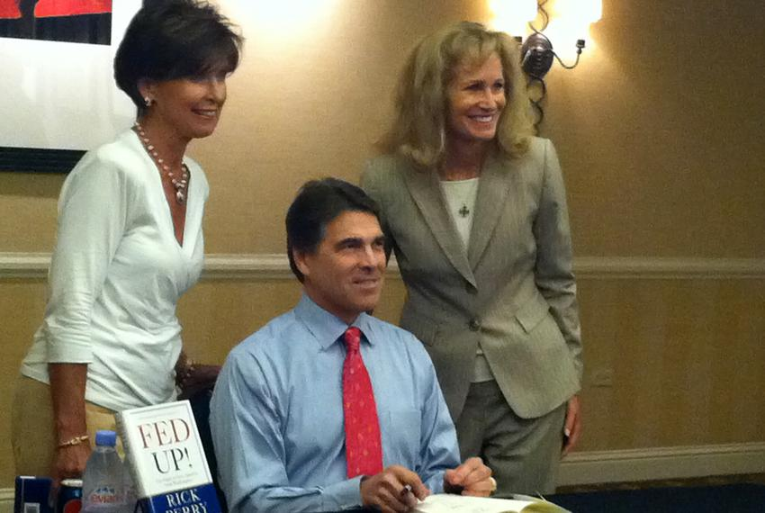 Perry signs books and poses for photos in Denver at Western Conservative Summit on July 29, 2011