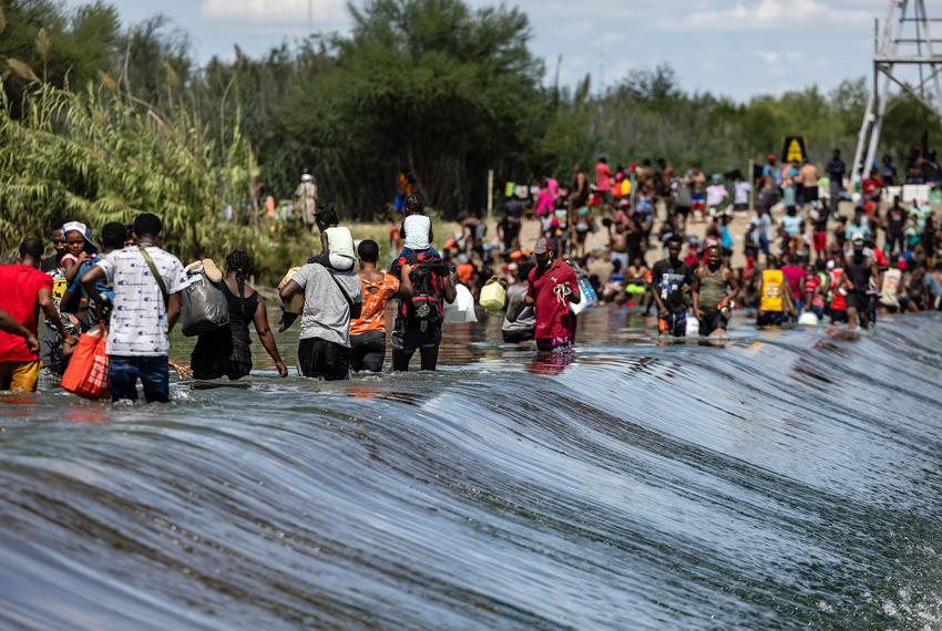 Migrants cross the Rio Grande between Del Rio (Texas) and Ciudad Acuña (Mexico) on September 16, 2021.