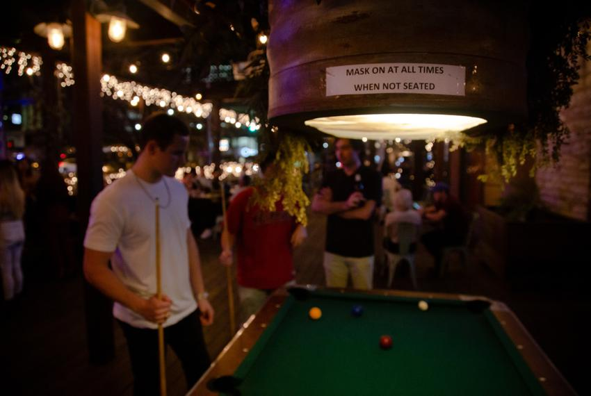 A small sign asks customers at Buford's bar in Downtown Austin to continue following COVID safety guidelines on March 12, 20…