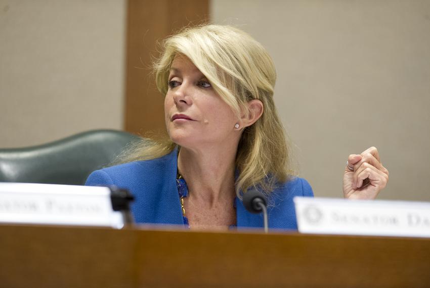 Sen. Wendy Davis, D-Fort Worth, listens after questioning Chairman Dan Patrick, R-Houston, on SB 23 in Senate Education Comm…