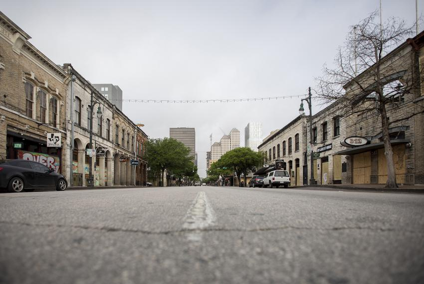 An empty Sixth Street during rush hour in downtown Austin. The city's streets were mostly empty as a result of the coronav...