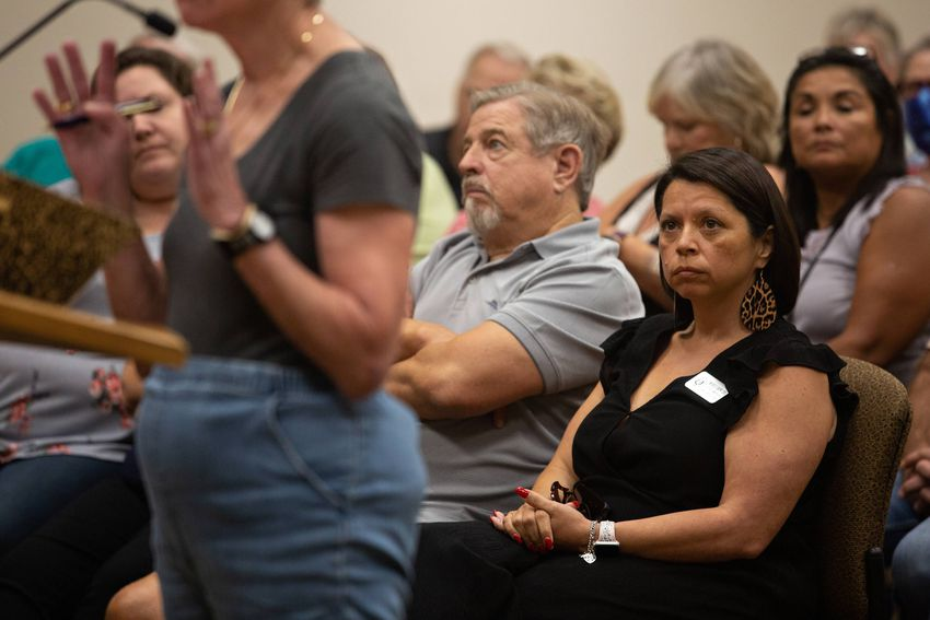 Election Administrator Michele Carew listens to public comments on her possible termination as Election Administrator during…