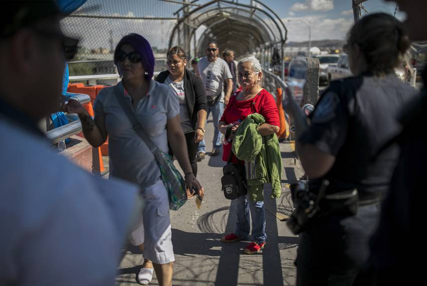 A dejected Bertha of Honduras looks back at her immigration lawyer Eduardo Beckett at the top of the international bridge ...