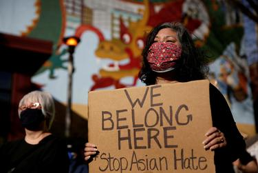 Protesters listened to speakers during a rally against anti-Asian hate crimes, organized by the Asian American Pacific Islanders Organizing Coalition Against Hate & Bias, at Hing Hay Park in the Chinatown-International District in Seattle on March 13, 2021.