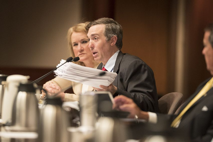 State Sen. Van Taylor,  R-Plano, holds 434 comments sent to him by constituents regarding large property tax increases during a Select Committee on Government Reform hearing on Saturday, July 22, 2017.
