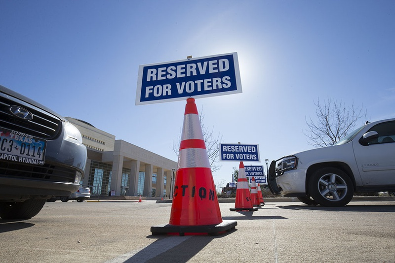 Reserved parking places awaited voters at the Hays County Government Center in San Marcos on Feb 25, 2016.
