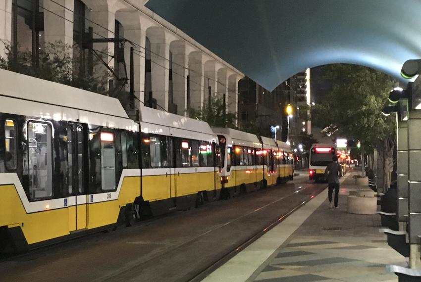 DART trains pull in and out of Akard Station in front of the transit agency's headquarters on Oct. 25, 2016.
