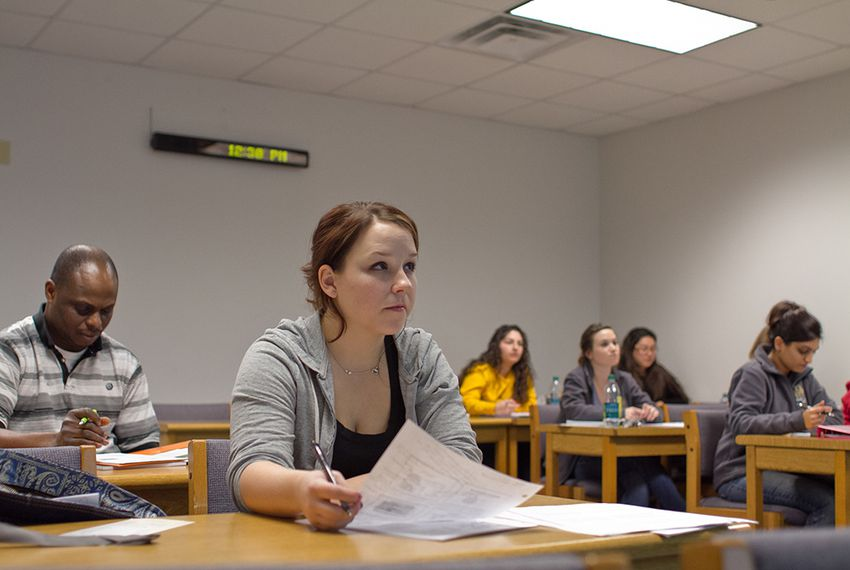 Chelsea Stewart listens to a lecture in the College of Health Professions at Texas State University.
