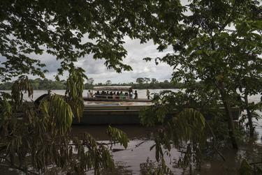 Migrants cross the Usumacinta River between La Técnica, Guatemala, and Frontera Corozal, México, on Oct. 21. The Usumacinta River acts as a border between the two countries. There is no immigration inspection in either of the two borders in the area.