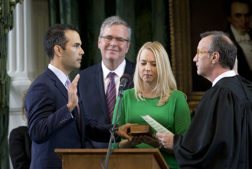George P. Bush is sworn in Jan. 2, 2015 as Texas land commissioner as dad Jeb Bush and wife Amanda look on.
