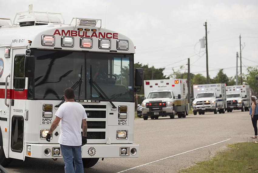 Amulances arrive at a middle school set up as a reunion point for parents and students in Santa Fe, Texas on Friday, March 1…