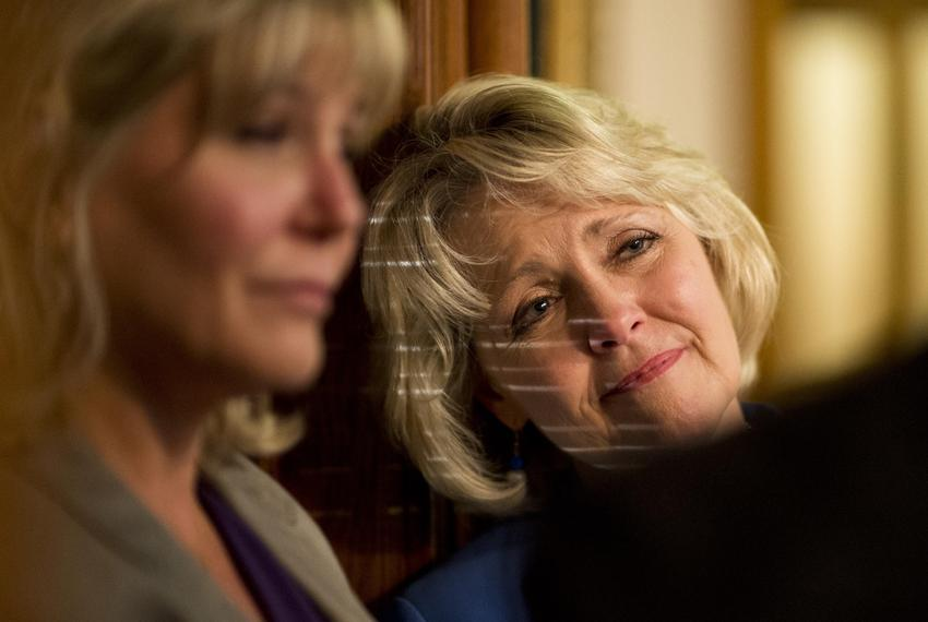 9:52 p.m. — Light streaks in through the House windows illuminating state Rep. Cindy Burkett, R-Sunnyvale, as she talks to a…