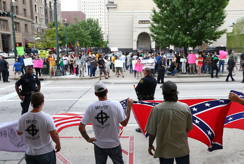 About a dozen people protested against what they called the threat of radical Islam, at the Islamic Da'Wah Center on Saturday, May 21, 2016, in Houston. They were met by several dozen counter-protesters.