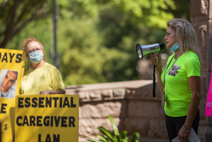 Angela Biggs speaks at a Texas Caregivers for Compromise rally in Austin on Aug. 8, 2020. Biggs' daughter, Amber Reynolds,...