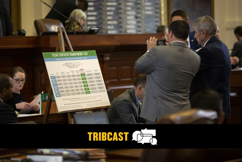 State representatives take a picture of the Texas Taxpayer Transparency Act on the House Floor.