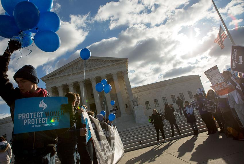Protesters on both sides of the issue face off in front of the U.S. Supreme Court on Capitol Hill in Washington, D.C. as W...