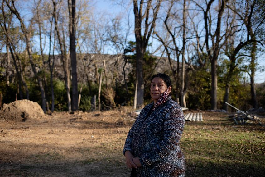 Cecilia Del Toro Garcia stands in her backyard, where Shingle Mountain is visible in the background. Her backyard, which was…
