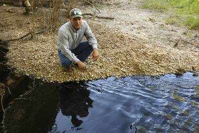 Colorado County Groundwater Conservation District board member Andrew Labay, who is also a fisheries biologist, near polluted water flowing in Skull Creek south of Columbus, Texas, on April 14, 2019.