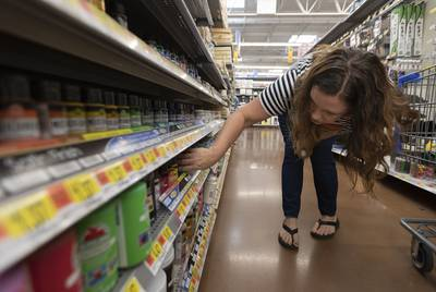 Rena Clegg, an art teacher at Pflugerville ISD, shops for supplies.