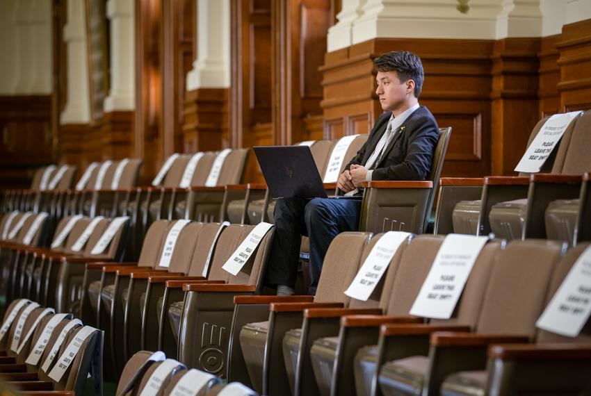 A man watches from the Senate gallery during session at the state capitol on May 25, 2021.