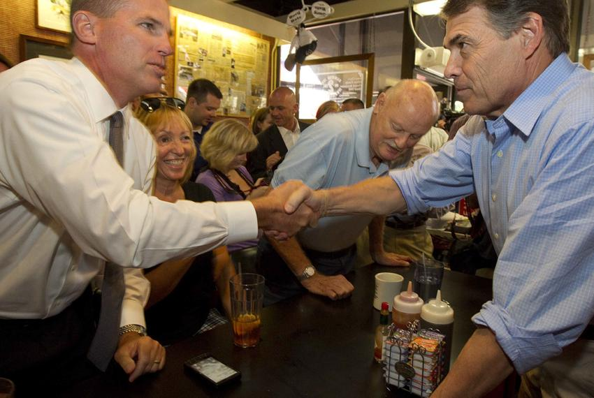 Texas Governor Rick Perry campaigns Monday at the Hamburg Inn restaurant in downtown Iowa City for the Republican presidenti…
