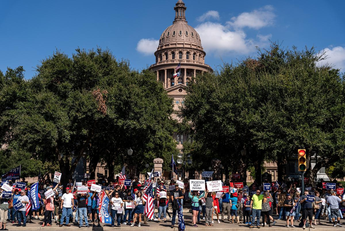 Supporters of President Donald Trump gather in front of the state Capitol for a