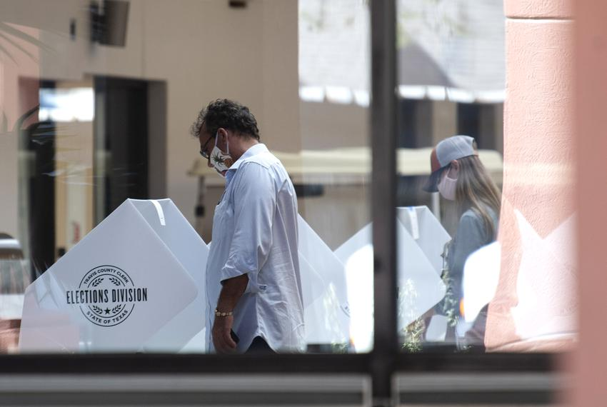 Voters cast their ballots at the Great Baptist Hills Church in Austin in July.