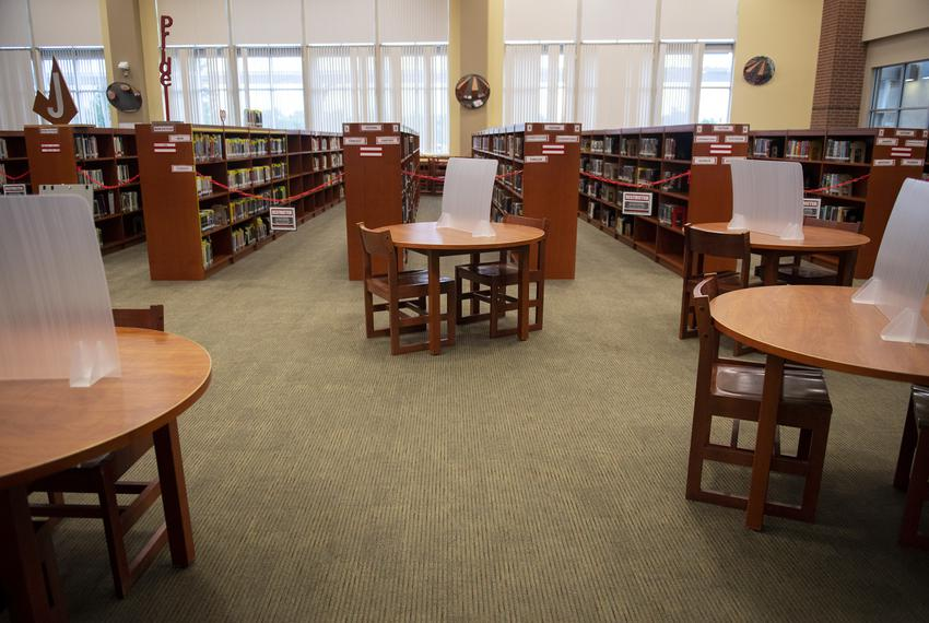 Partitions sit on a table in the library at Judson High School on Tuesday, Aug. 11, 2020 in Converse. The librarian purchase…