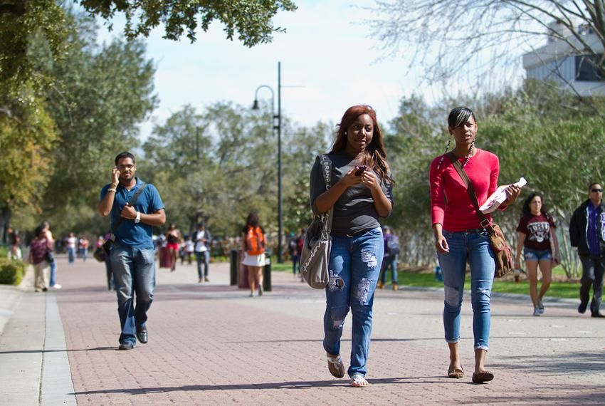 Texas Southern University students Chassity Piece (center) and Briana Falls (right) walk to class on Feb. 22, 2012.