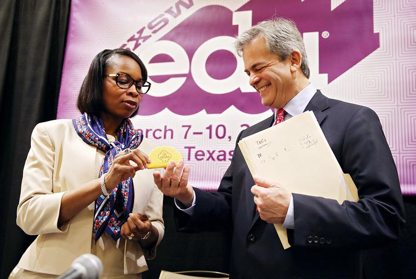 Mayor of San Antonio Ivy Taylor gifts the mayor of Austin Steve Adler a taco stress toy at the conclusion of the Taco Summ...