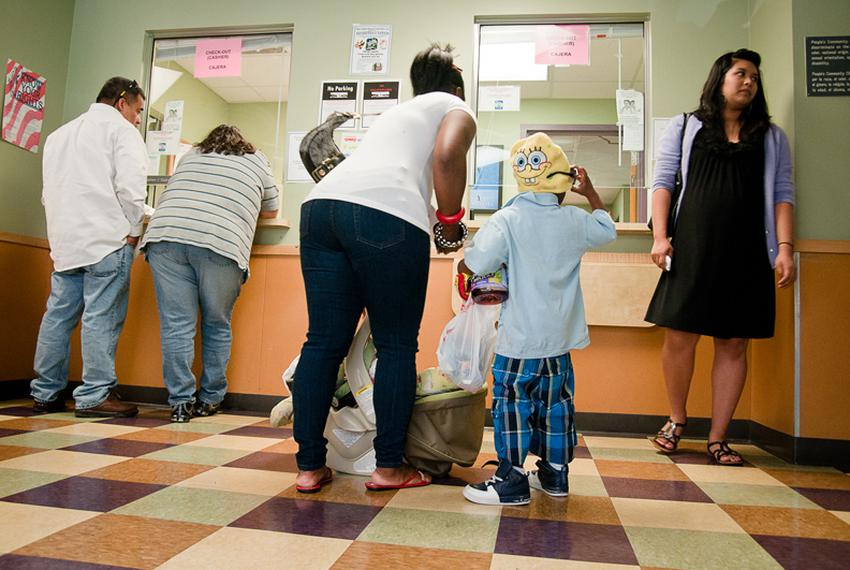 Patients are shown checking out in 2010 at the People's Community Clinic in Austin, a safety-net clinic that serves Medicaid…