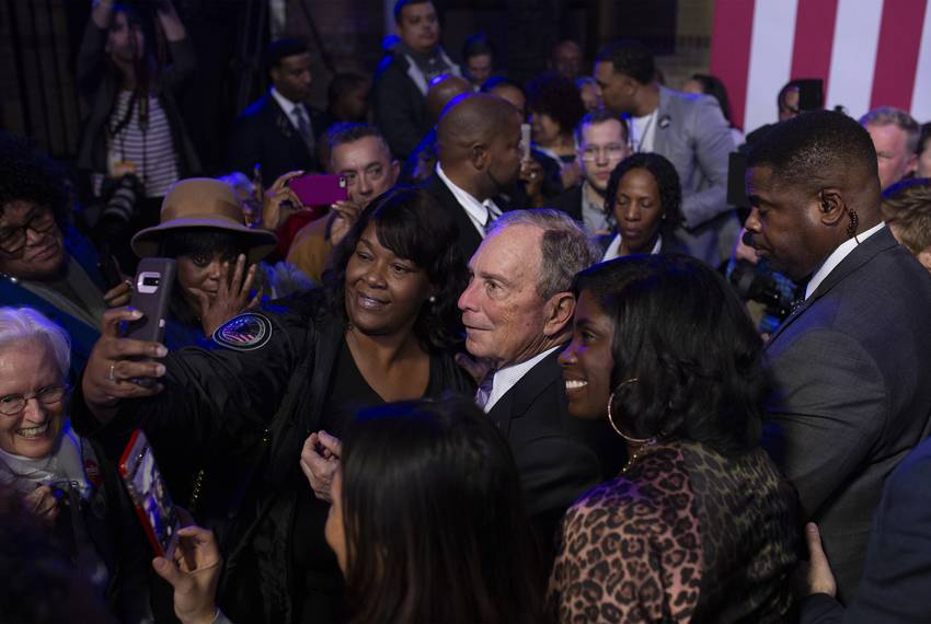 Democratic presidential  candidate Mike Bloomberg takes photos with supporters during a campaign event at the Buffalo Sold...