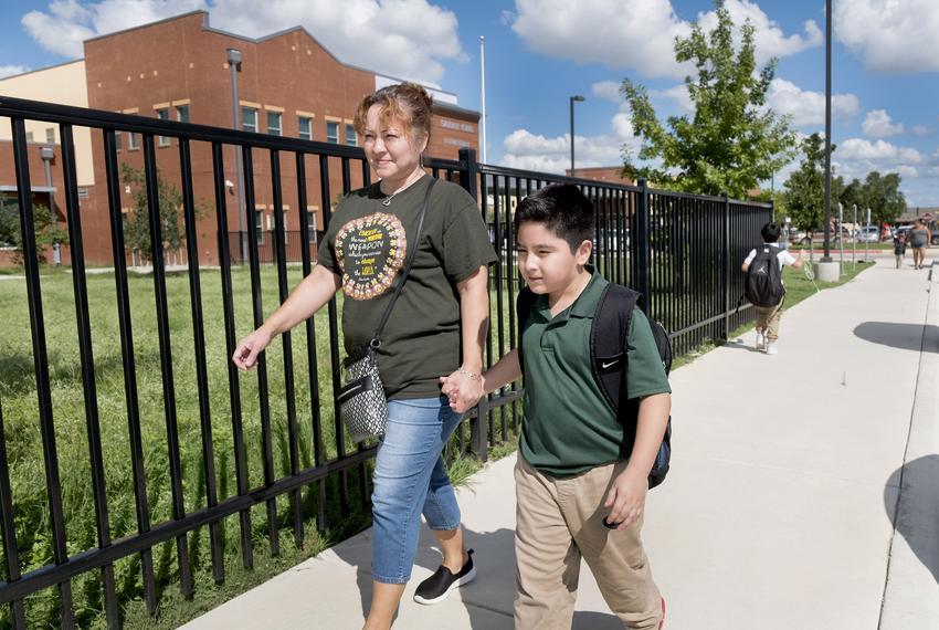 Maria Blanco walks her son, Sebastian Blanco, home from Sarah King Elementary School in San Antonio.
