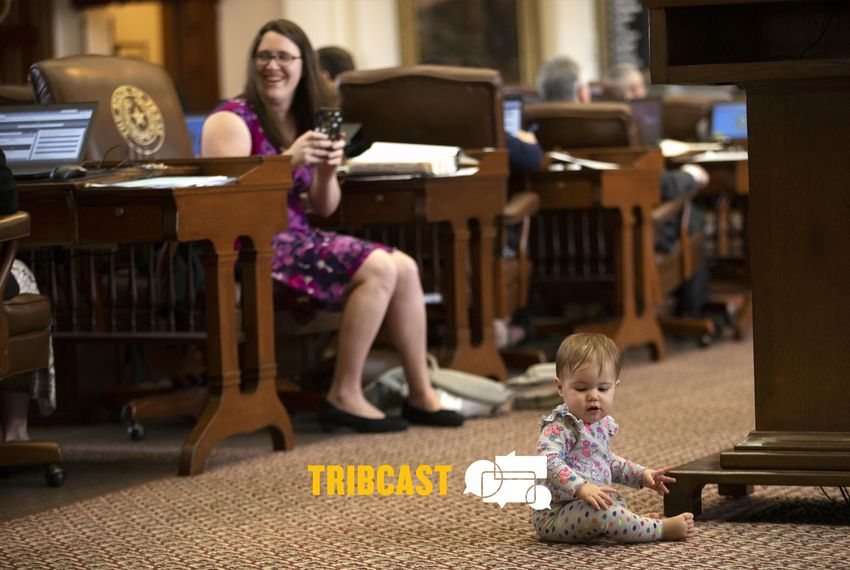 State Rep. Erin Zwiener, D-Driftwood, smiles at a colleague as her baby plays on the Texas House floor on April 17, 2019.